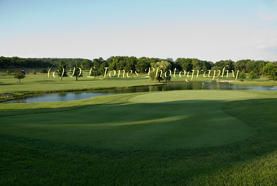 The 17th hole at Lake Valley is a par 3 with water behind and left of the green.  (E231 www.lakevalleygolf.com)