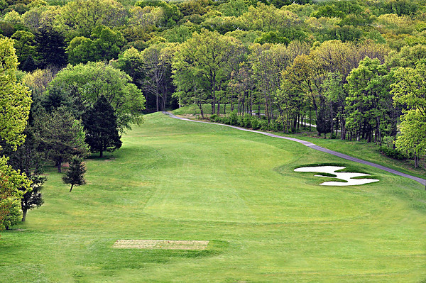 VIEW OF THE 2ND HOLE FAIRWAY REDESIGNED SO THAT IT IS NOW A PAR 5 DOGLEG LEFT UPHILL.