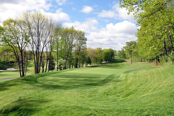 THIS IS A SHOT TAKEN OF THE 7TH HOLE PAR 4 FROM BEHIND THE 2 TIERED GREEN.