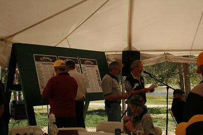John Erwin, Dennis Troutman and Jerry Nissen go over winnters