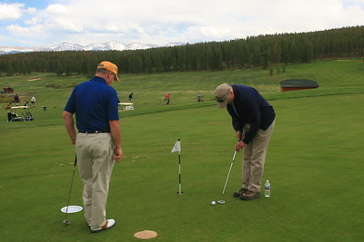 Stan Meyer (L) watches the ace Ron Nelson putt - that is a pretty short putt Ron - don't miss it.