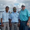 Two boat captians and tournament director Tom on Nevis dock