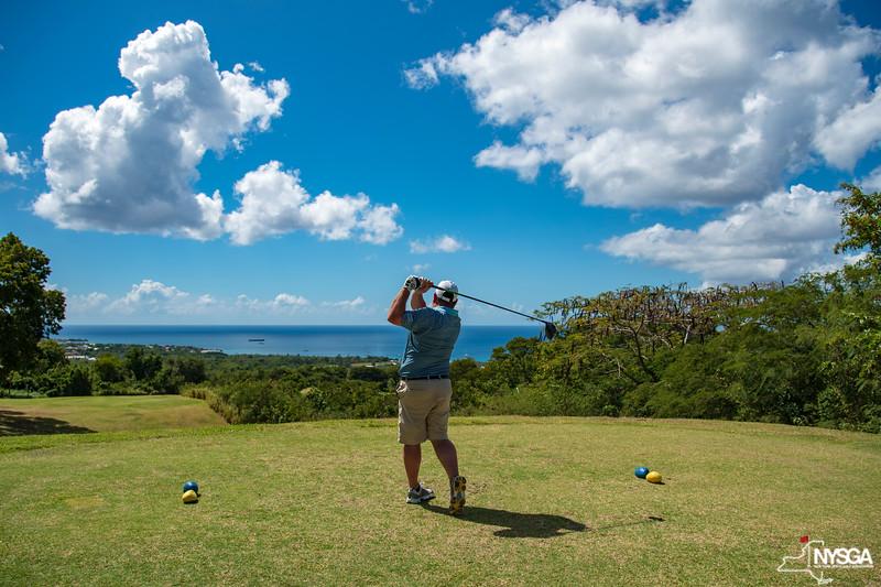 Teeing off towards the ocean at Robert Trent Jones II Golf Course at Four Seasons Resort on Nevis