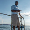 A crew member on the short boat ride back to St. Kitts after the 2nd round of the 2019 St. Kitts & Nevis Admirals Cup at Robert Trent Jones II Course at Four Seasons Resort on Nevis