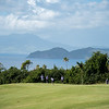 A pro-am team putting out on Robert Trent Jones II Golf Course on Nevis