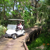 Louise on wooden bridge at Diamondback GC