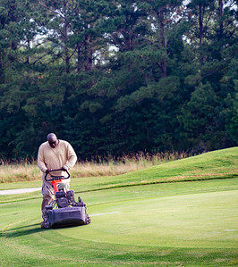 Mowing the edges with a special machine.