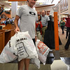 Two-time Masters champion Bubba Watson shows off his bags full of merchandise after shopping at the UGA Bookstore during his visit to Athens, Ga., on Monday, April 21, 2014. (Photo by Steven Colquitt)