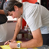 Two-time Masters champion Bubba Watson signs a Masters flag during his visit to Athens, Ga., on Monday, April 21, 2014. (Photo by Steven Colquitt)