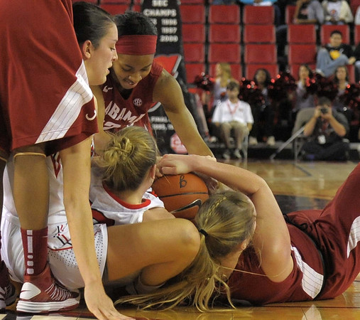 Merritt Hempe  and Anne Marie Armstrong in the middle of a battle for the ball during the Georgia Bulldog's game against the Alabama Crimson Tide at Stegeman Coliseum on Wednesday, January 30, 2013.<br /> <br /> (Photo by John Kelley