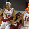 Jasmine Hassell and Merritt Hempe battle for a loose ball during the Georgia Bulldog's game against the Alabama Crimson Tide at Stegeman Coliseum on Wednesday, January 30, 2013.<br /> <br /> (Photo by John Kelley