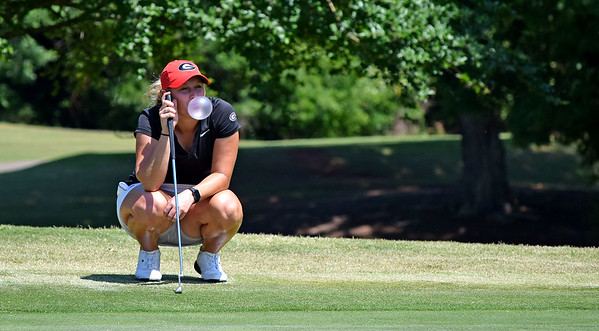 Georgia's Bailey Tardy blows a bubble as she waits on the green during the NCAA Regional at the UGA Golf Course in Athens, Ga., on Tuesday, May 9, 2017. (Photo by Steven Colquitt)