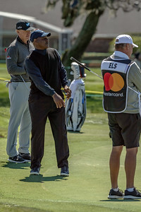 NFL Hall of Fame Derrick Brooks Putts As Ernie Els Looks On