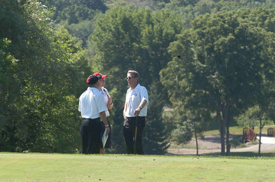 The Mayor getting last minute instructions for the Mayor Long Drive Challenge