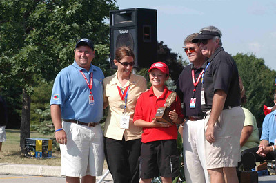 Ben helps to receive the Golf Championship trophy