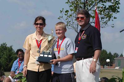 Lukas receives the boys trophy on behalf of the Hamilton Boys Team