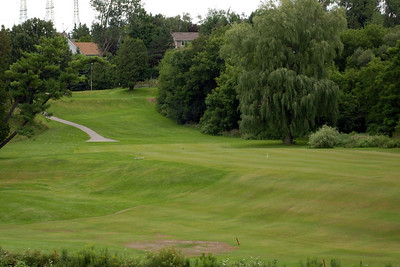 The view from the first green back up to the tee
