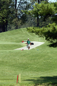 With a 2 stroke lead going into the 18 of round 2, Nick goes for a low percentage 210 yd approach instead of laying up.  With exacting precision and the luck of the Irish (bouncing a low streamer off some branches), he lands one for a 2 foot eagle attempt ... which he made.