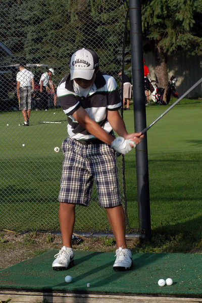 warming up for his round 1 8:20 AM tee-off
