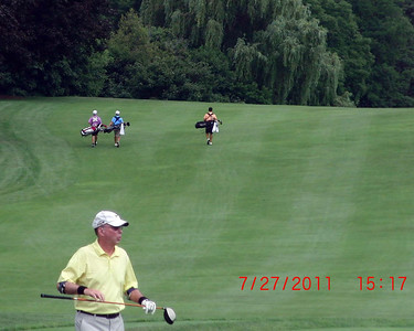 The boys are off after their first tee (which was captured in SloMo and posted on http://www.youtube.com/watch?v=xyovV2qx9x4).  The golfer in the foreground is Mike Dore whose wife was Mom's teaching partner for many many years.