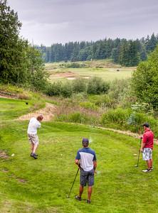 men-playing-golf