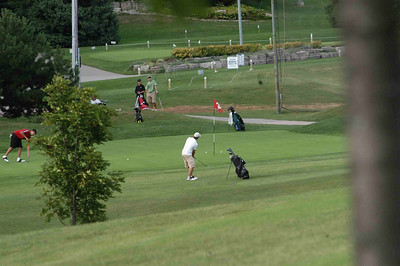 Eric chipping for a birdie on the 9th