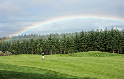 A 7 iron under the rainbow at Trophy Lake
