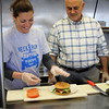 Marblehead, Ma. 5-14-17. Erica Petersiel and George Markos prepare a hamburger at the Neck Run Cafe on Ocean Street in Marblehead.