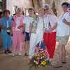 "John Van Dusen's mother (being consoled) with other Gold Star Mothers inside a ""Wonder Arch"" at the former Dong Ha Combat Base near the spot where her son Jon was killed"