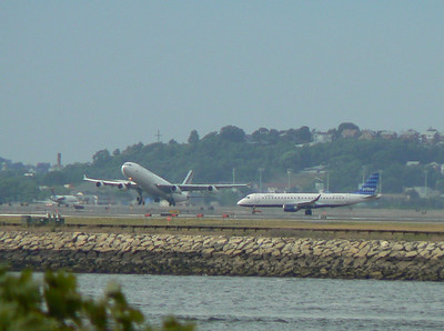 Air France A340 taking off whle jetBlue E190 taxis to Terminal C.