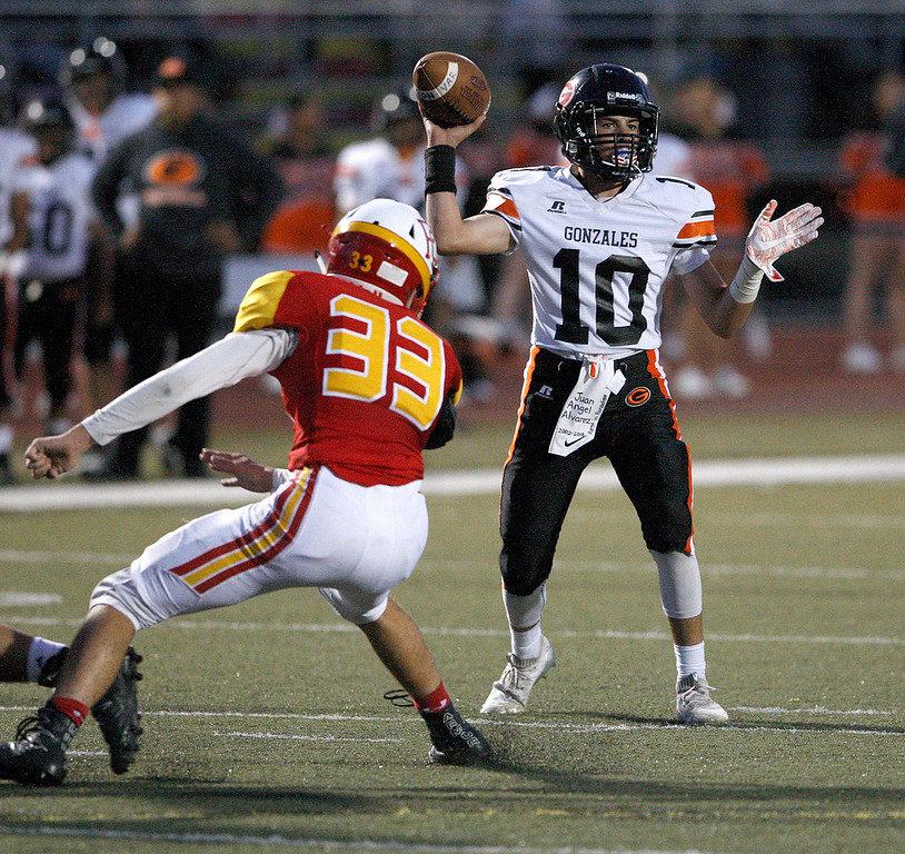 . Gonzales High School\'s Jayson Flores (10) attempts a pass during their game against Pacific Grove High School on Friday, August 31, 2018.  (Vern Fisher - Monterey Herald)
