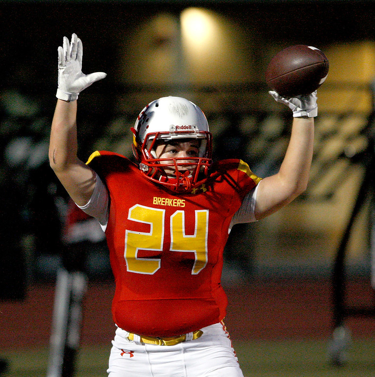. Pacific Grove High School\'s Anthony DaSilva (24) celebrates a touchdown run in the first-half during their game against Gonzales High School in Pacific Grove on Friday, August 31, 2018.  (Vern Fisher - Monterey Herald)