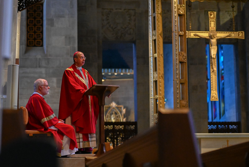 Archbishop William E. Lori celebrates Good Friday services to a livestream audience from the Cathedral of Mary Our Queen in Homeland April 10, 2020. The cathedral was empty due to quarantine restrictions caused by the coronavirus pandemic. (Kevin J. Parks/CR Staff)