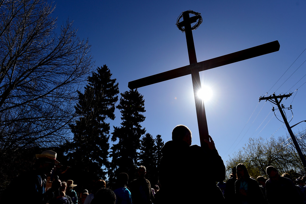 . LONGMONT, CO - APRIL 19:Tom Simmons, of Longmont, holds the cross while at a stop near Central Elementary School during the annual Good Friday Walk in Longmont on April 19, 2019.  (Photo by Matthew Jonas/Staff Photographer)