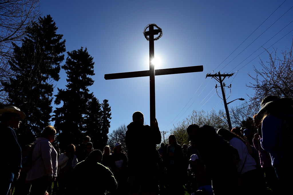 . BEST1 LONGMONT, CO - APRIL 19:Tom Simmons, of Longmont, holds the cross while at a stop near Central Elementary School during the annual Good Friday Walk in Longmont on April 19, 2019.  (Photo by Matthew Jonas/Staff Photographer)