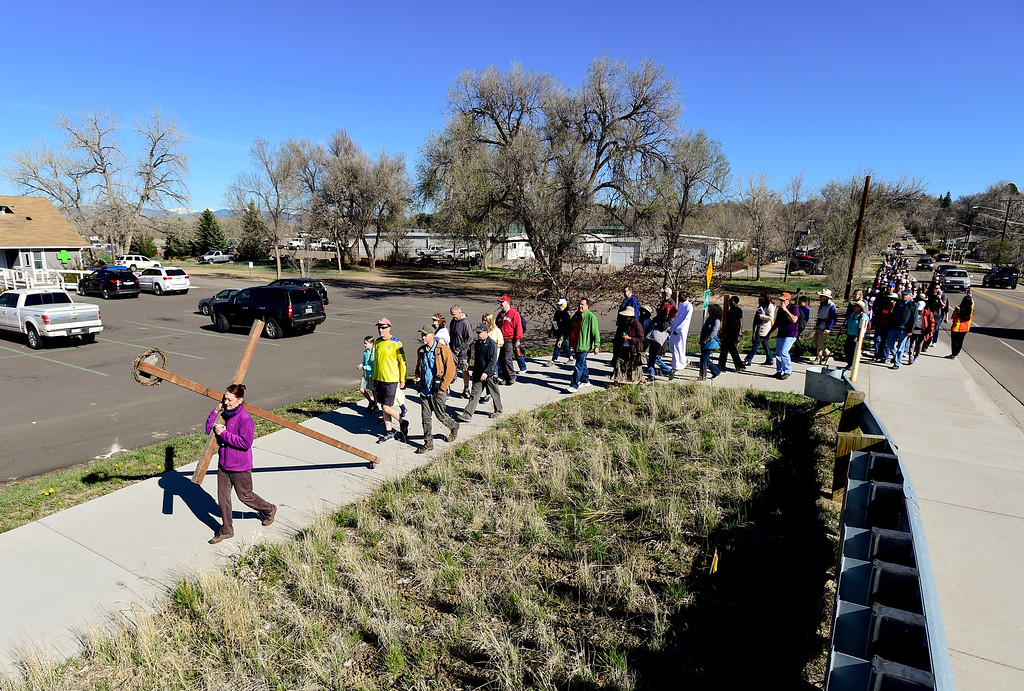. LONGMONT, CO - APRIL 19:The procession enters the Greenway Trail off Sunset Street during the annual Good Friday Walk in Longmont on April 19, 2019. (Photo by Matthew Jonas/Staff Photographer)