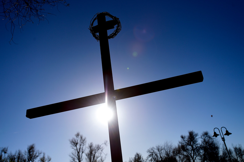 . LONGMONT, CO - APRIL 19:The sun shines on the cross before the start of the annual Good Friday Walk in Longmont on April 19, 2019.  (Photo by Matthew Jonas/Staff Photographer)