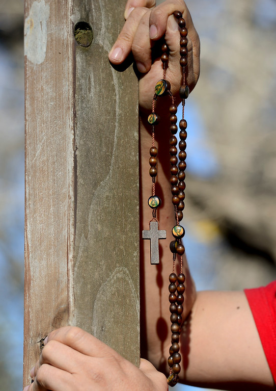 . LONGMONT, CO - APRIL 19:Pedro Solis, of Longmont, holds the cross and his rosary beads while at a stop during the annual Good Friday Walk in Longmont on April 19, 2019. (Photo by Matthew Jonas/Staff Photographer)
