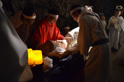 Jesus in the tomb. Fr. Joseph helps to place the body.