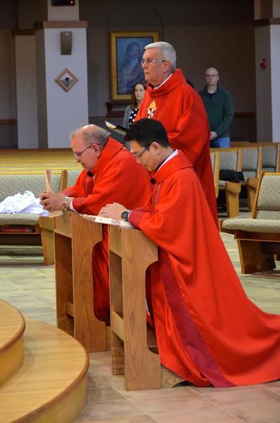 Prayer before the altar