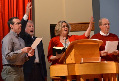 Members of the choir lead the response