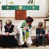 3 Pastor prays with kids - Sunday morning services