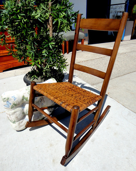Impeccably Maintained Solid Wood Mini-Rocker with Closed Wicker Accents.  18 x 27 x 34.  <b>$95</b>