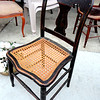 Distinctive Black Hitchcock-Style Antique Chair with Wicker Seat.  17 x 17 x 34.  <b>$85</b>