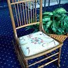 Stylish Needlepoint Upholstered Vintage Solid Wood Rocker.  This rocking chair is full of vintage charm, from the ball point finials to the spindle chair back and the light wood frame... not to mention the darling embroidery!  It measures 18 x 28 x 35.  Great Condition.  <b>$125</b>