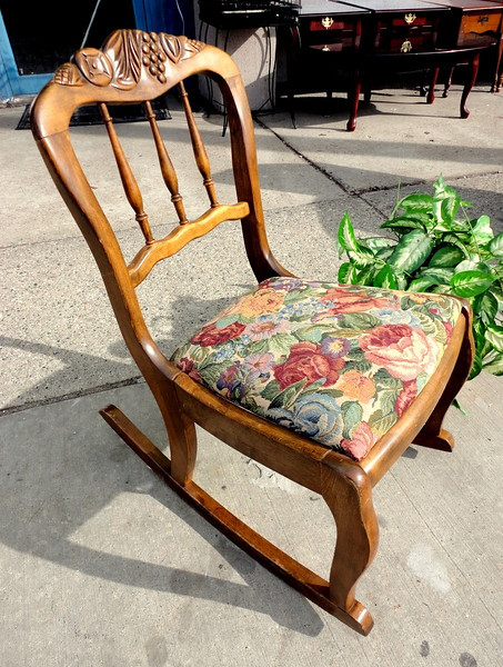 Delightful Vintage Solid Wood Mini-Rocker.  Early American carved motif and spindle back detailing.  18 x 26 x 30.  <b>$85</b>