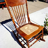 Beautiful Hand Carved Solid Wood Rocker with Wicker Accent in Excellent Condition.  19 x 32 x 35.  <b>$125</b>