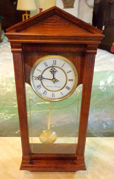 Seiko Wall Clock, Mahogany.  Accent your home with the rich mahogany elegance of this wall clock from Seiko. Solid mahogany case with glass window and brass pendulum. Round white dial with gold-tone accents, roman numeral indices and logo. Westminster/Whittington quarter hour chime and hourly strikes.  <b>$75</b>