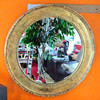 Unique 34-inch Round Bronze-Look Wall Mirror.  <b>$165</b>