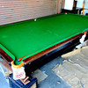 Hard-to-Find Antique Brunswick Balke Collender Pool Table.  Super collectible antique table.  Solid oak in a weathered oak finish. Distinct points of superiority in this design of table, including  * The slate bed is best quality Vermont one inch thick, the sections being joined with brass dowels and sockets. No screw holes on the playing surface.  * The cushions are the celebrated quick acting Monarch, guaranteed the most perfect angle cushion in the world. Preferred by all professional players in America and Europe.  A little restoration could easily triple the value of this remarkable table.  <b>$2,995</b>